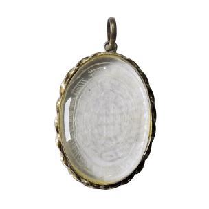 Satyamani 12-Zodiac Symbol Engraved Overlay in Clear Quartz Pendant